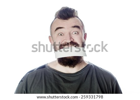 Bearded man holding a blank paper in his mouth