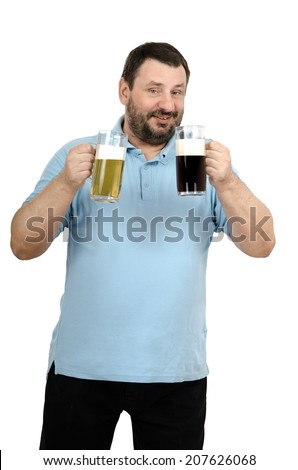 Bearded man in blue polo t-shirt intending to drink stout then lager beer tankard on white background - stock photo