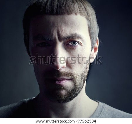 bearded man portrait, lit from the side - stock photo