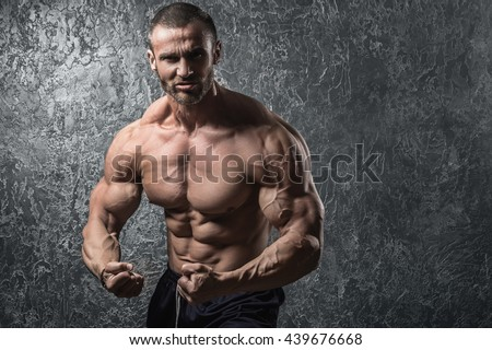Bearded man showing his muscles