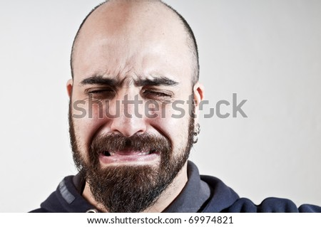 bearded man who cries on white background