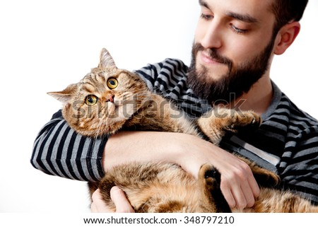 Bearded man with his beautiful cat on white background. People and pets.  lifestyle