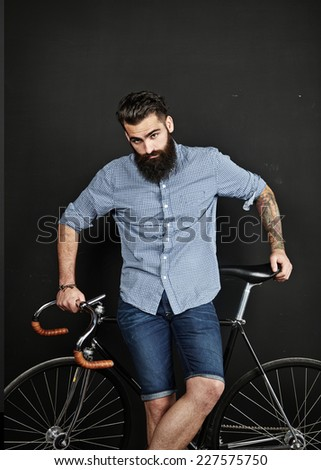 Bearded man with vintage bicycle - stock photo