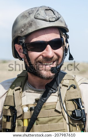 Bearded SEAL team member in the desert