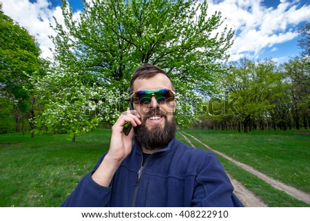 bearded smiling man talking on the phone, self portrait picture