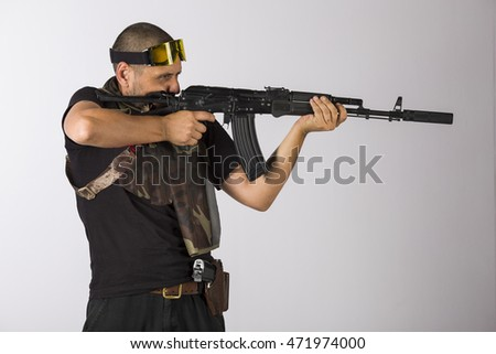 Bearded soldier armed with russian mashinegun