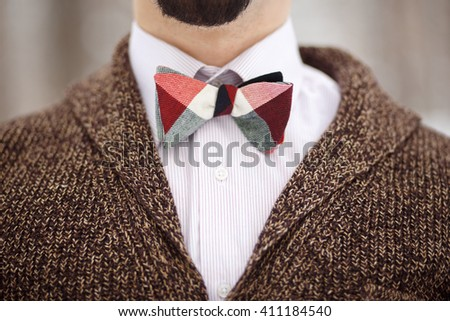 Bearded unrecognizable man in checked bow-tie