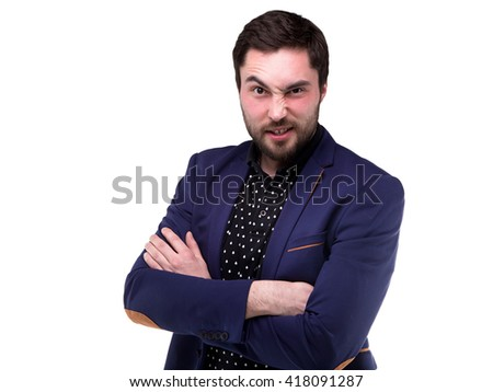 Bearded young man with grimace