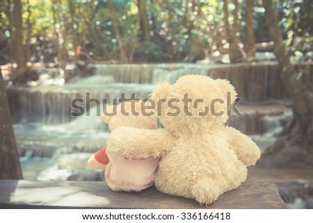 Bears in love hugs in vintage waterfaii background - stock photo