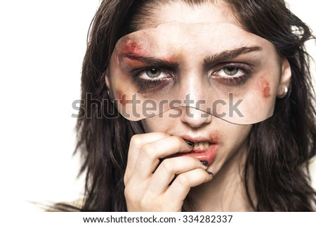 Beaten up girl portrait with big eyes