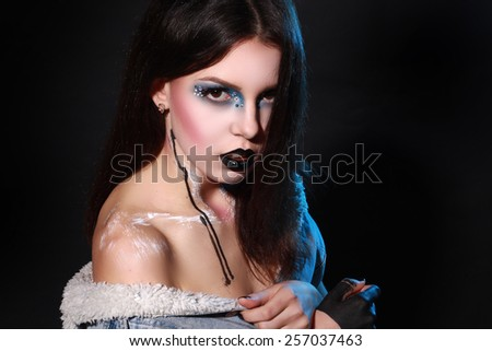 Beatiful girl with creative black make-up
