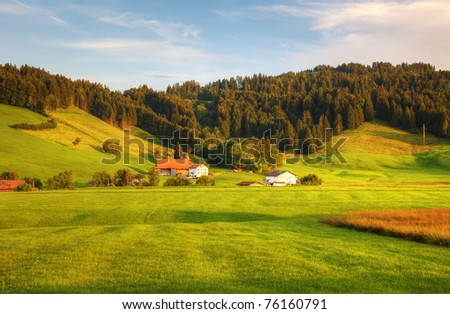 Beatiful hillside before sunset in swiss Alps, Europe. - stock photo