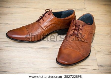 Beatiful pair of brown luxurious men's leather shoes. - stock photo