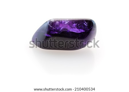 Beatiful purple/violet amethyst on a white background. - stock photo