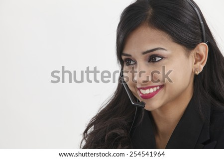 beatiful receptionist wearing headset smiling - stock photo