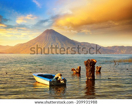 Beatiful sunset at the lake Atitlan near the volcano.  Guatemala - stock photo