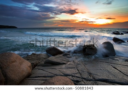 Beatiful sunset on the rocks - stock photo