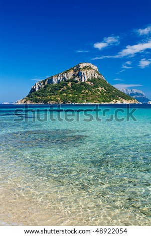 Beatiful view of sea landscape in sardinia with wonderful blue color and an island far away - stock photo
