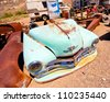 BEATTY, NV - MAY 5:  Junkyard with Vintage Plymouth car in Beatty Nevada on May 5, 2012.  This landmark desert, mining town of Beatty is the last town before entry to Death Valley National Park. - stock photo