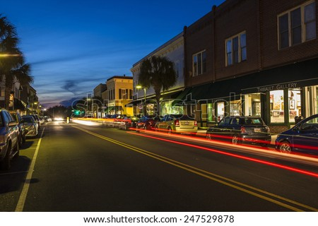 BEAUFORT, SOUTH CAROLINA-FEBRUARY 24, 2014: Traffic drives past the downtown historic district of Beaufort, South Carolina in this time exposure. - stock photo