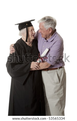 Beauitiful Caucasian woman in a black graduation gown being congratulated by her husband for graduating from university isolated on a white background