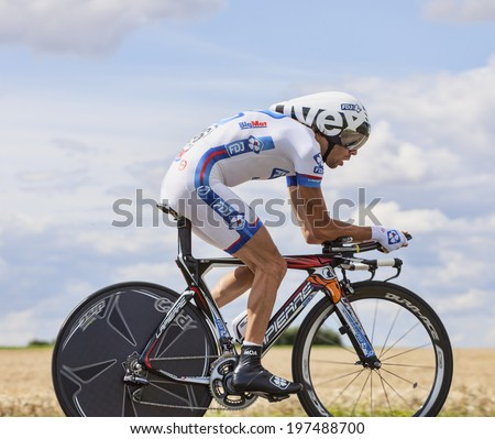 BEAUROUVRE,FRANCE,JUL 21:The French cyclist Thibaut Pinot from FDJ Team pedaling during the 19 stage- a time trial between Bonneval and Chartres on July 21 2012 - stock photo
