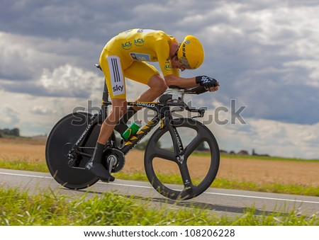 BEAUROUVRE,FRANCE,JUL 21:The winner of Le Tour de France 2012,Bradley Wiggins  wearing the Yellow Jersey during the 19 stage- a time trial  between Bonneval and Chartres on July 21 2012. - stock photo