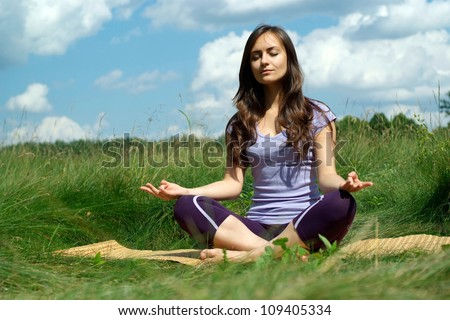 Beauteous brunette went to rest on the nature - stock photo