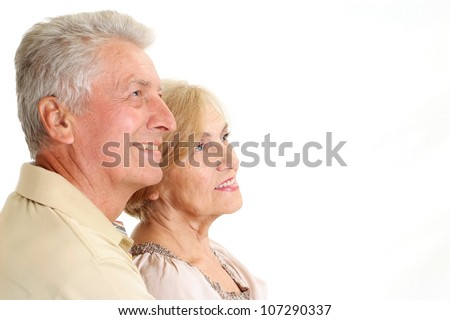 Beauteous elderly couple on a white background