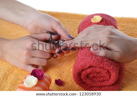 Beautician cutting fingernails before manicure, isolated - stock photo