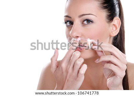Beautician depilating a woman with wax - stock photo