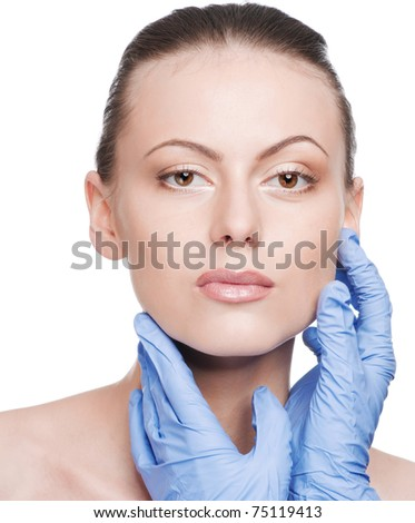Beautician touch and exam health woman face. Plastic surgery. Isolated