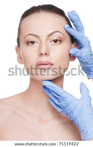 Beautician touch and exam health woman face. Plastic surgery. Isolated - stock photo