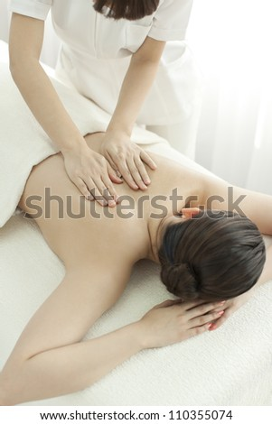 beautician who massages the back - stock photo
