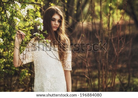 beautidul brunette woman walking outdoors, dramatic theme - stock photo