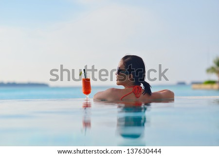 beautifu and happy woman girl on beach have fun and relax on summer vacation  over the sea - stock photo