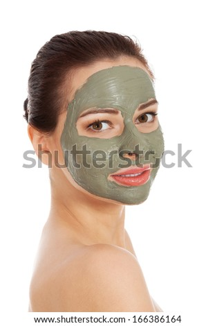 Beautifu toplessl woman with facial mask. Spa concept. Isolated on white.