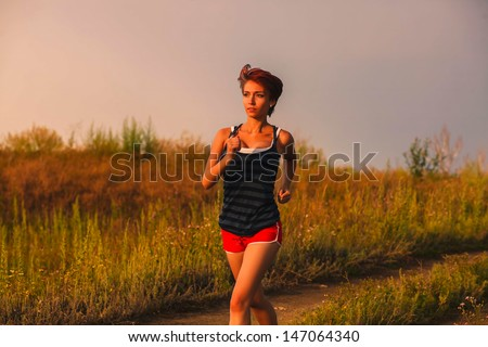 beautiful a healthy runs young brunette woman athlete running outdoors, fitness and healthy lifestyle, running - stock photo