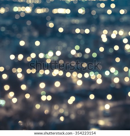 beautiful abstract blue circular bokeh background, city lights with horizon and instagram style, closeup  - stock photo