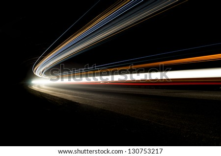 Beautiful abstract lights in a car tunnel in orange, white, blue