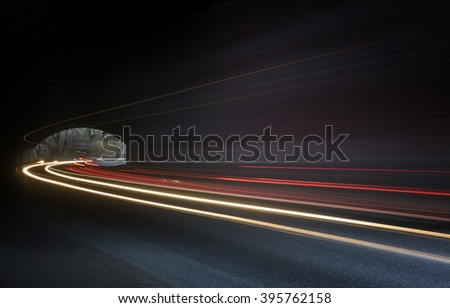 Beautiful abstract lights in a car tunnel in white, green, purple - stock photo