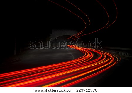 Beautiful abstract lights in a car tunnel in white, green, purple,red - stock photo
