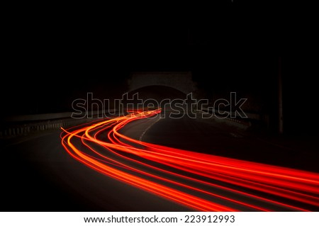 Beautiful abstract lights in a car tunnel in white, green, purple,red