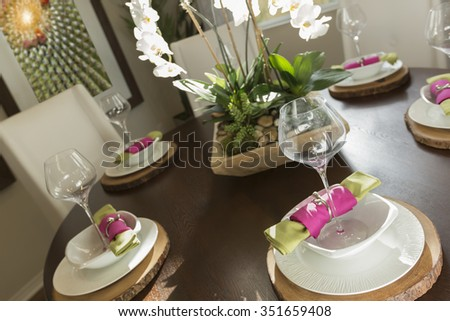 Beautiful Abstract of Dining Table with Place Settings.