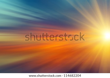 Beautiful abstract sun with rays at sunset - stock photo