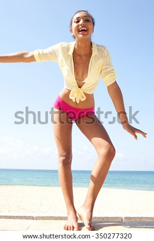Beautiful adolescent african american healthy teenager carefree on a sunny beach destination against a blue summer sky, outdoors. Adolescent joyful expressions wellness lifestyle, colorful exterior. - stock photo