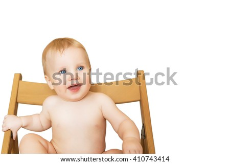 Beautiful adorable laughing baby boy infant face, isolated on white background with free text place. Smiling blue-eyed child sits on a chair - stock photo
