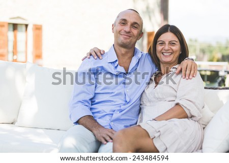 Beautiful Adult Couple Embraced Outdoor - stock photo