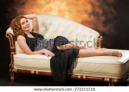 Beautiful adult sexy woman sitting on chair - stock photo