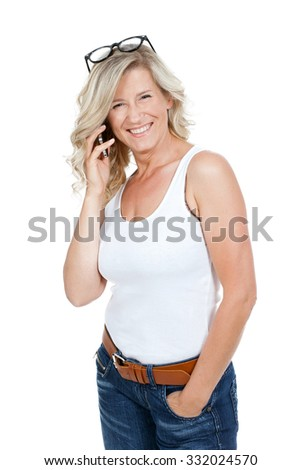 Beautiful adult woman, blonde, smiling, beautiful face holds in his hands the phone rings, writes sms - stock photo